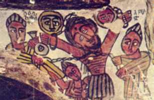 Ancient Coptic mural from the monastery of Petros and Paulos near a village called Sinkata in Ethiopia. Jesus is bound, apparently by chains, perhaps to a beam or to a rocky ledge, but not crucified in the conventional sense. He could easily be Prometheus.